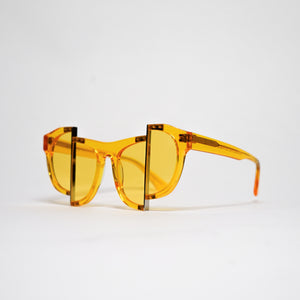 yellow jelly colour acetate frame with matching colour split polaroid lens on a 45 angle