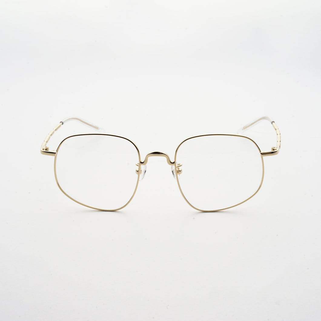 pale gold colour stainless steel optical frame with morse code details on the temples front