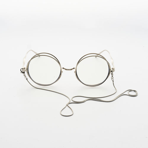 round crossed rims optical frames with chain in chrome colour front