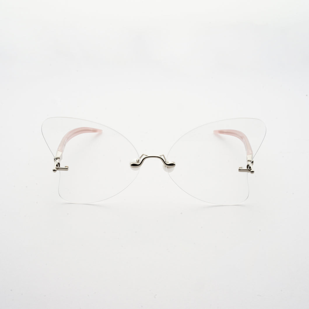 heart shaped lens with pearl nose pads and fountain pen style temples front