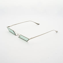 Load image into Gallery viewer, sunglasses with rhombus shaped mint lens and silver frames 45 angled