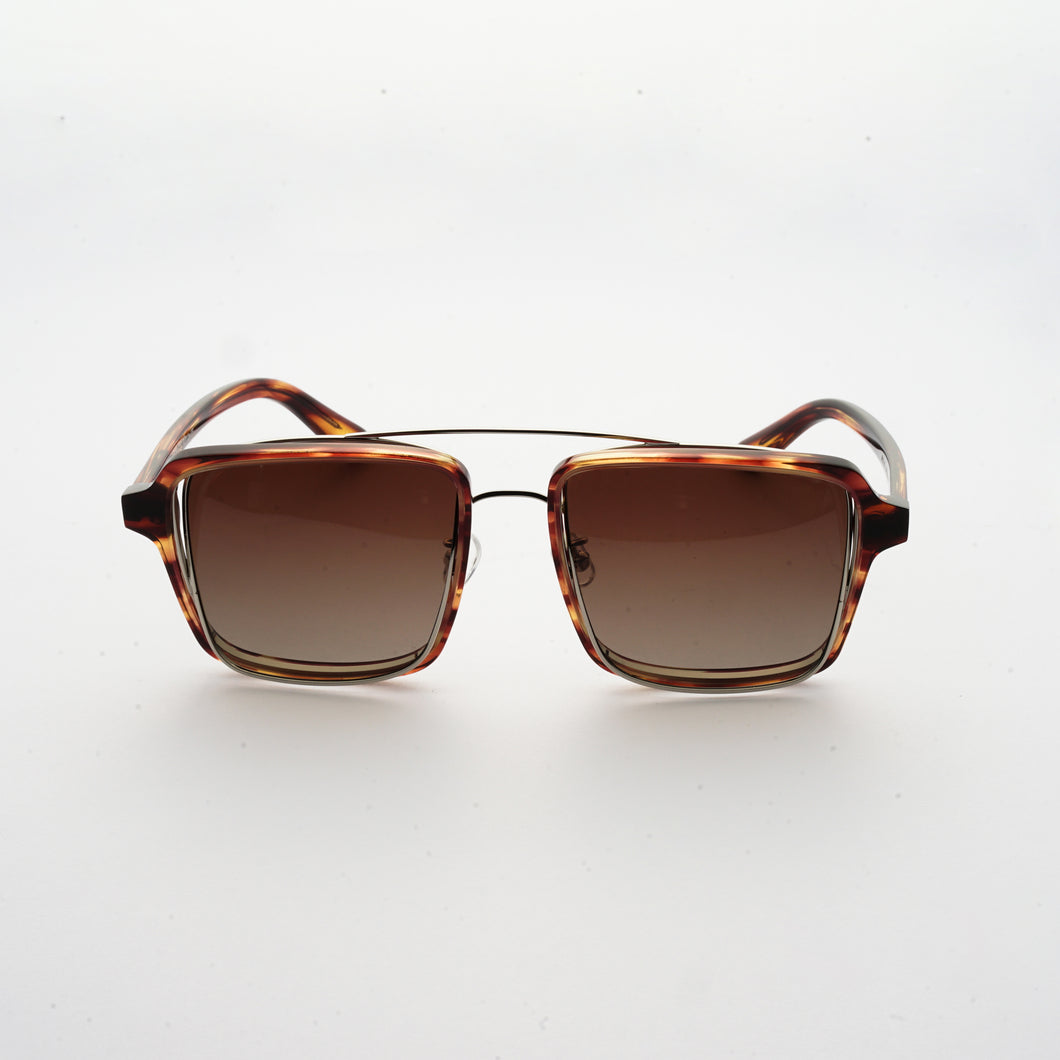 testudinarious acetate frame with crossed gold rims and gradient brown lens front