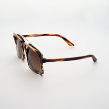 Load image into Gallery viewer, testudinarious acetate frame with crossed gold rims and gradient brown lens 45 angled