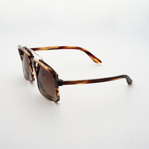 testudinarious acetate frame with crossed gold rims and gradient brown lens 45 angled