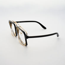 Load image into Gallery viewer, black acetate frame with crossed gold rims and clear nylon lens 45 angled 1