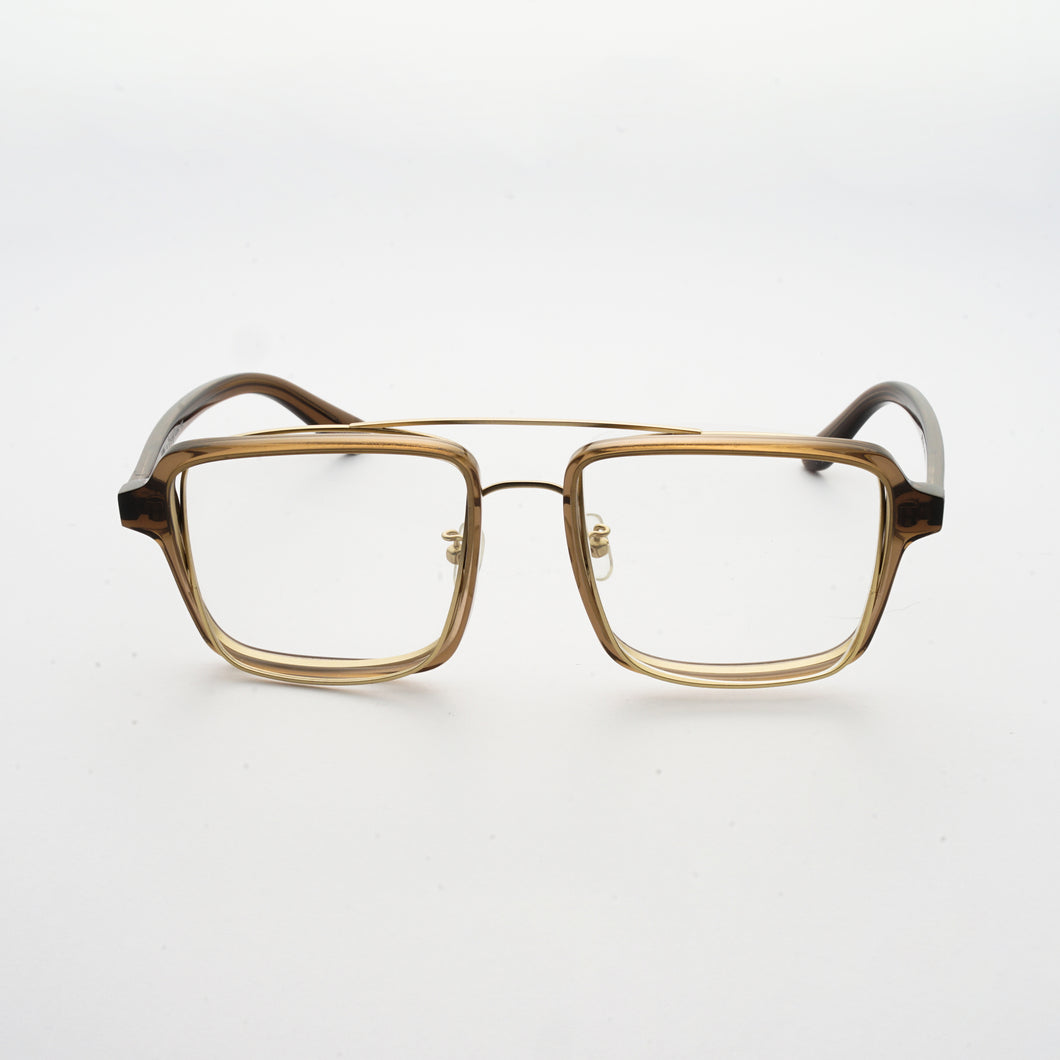 transparent brown acetate frame with crossed gold rims and clear nylon lens front