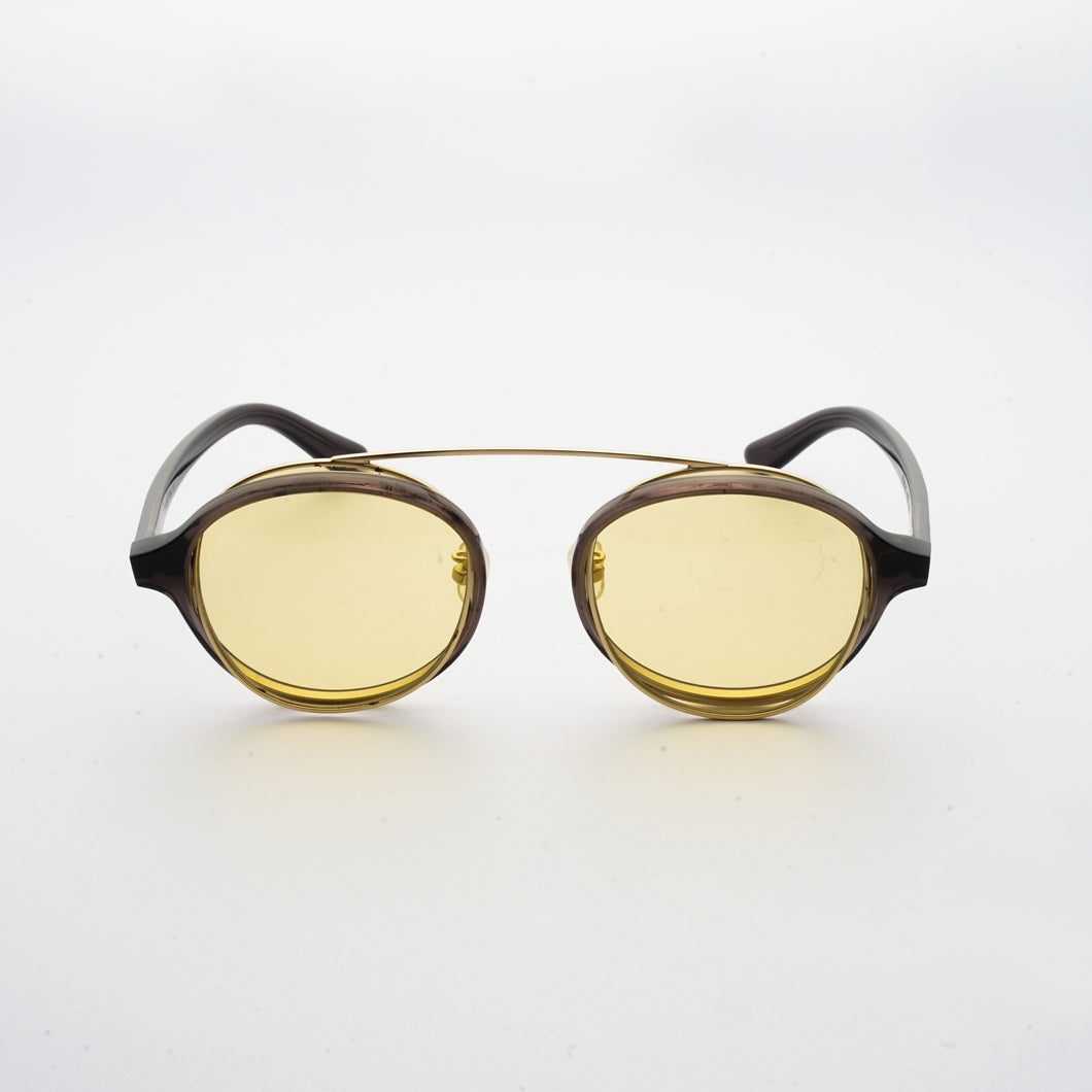 brown acetate round frames with crossed gold rims and light yellow nylon lens front