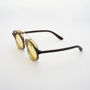 brown acetate round frames with crossed gold rims and light yellow nylon lens 45 angled