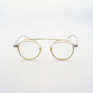 clear acetate round frames with crossed gold rims and clear nylon lens front