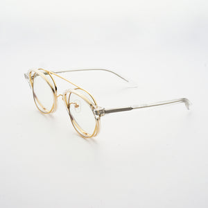 clear acetate round frames with crossed gold rims and clear nylon lens 45 angled