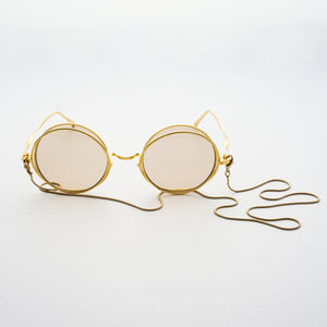 round crossed rims optical frames with chain in gold colour front