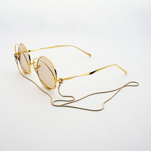 round crossed rims optical frames with chain in gold colour 45 angled