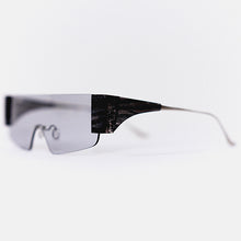 Load image into Gallery viewer, wide safety goggles style sunglasses with grey one-piece lens and marble acetate hinges 45 angled
