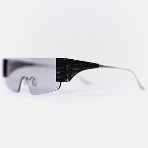 wide safety goggles style sunglasses with grey one-piece lens and marble acetate hinges 45 angled