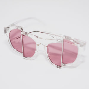 clear acetate frame with dark pink split polaroid lens 45 angled