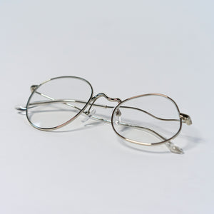 liquified round frames in chrome colour with clear nylon lens temples folded up