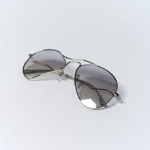 Load image into Gallery viewer, liquified aviator frames in chrome colour with grey polaroid lens temples folded up