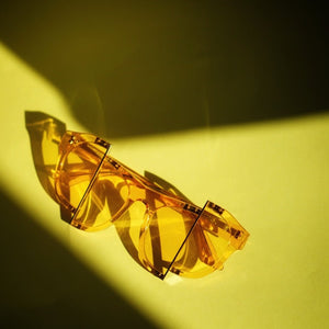 yellow jelly colour acetate frame with matching colour split polaroid lens under the sun