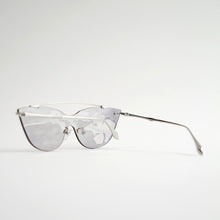 Load image into Gallery viewer, sunglasses in chrome stainless steel frames with colour changing photochromic one-piece lens exposed in day light45 angled