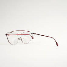 Load image into Gallery viewer, sunglasses in red stainless steel frames with colour changing photochromic one-piece lens before exposing in day light45 angled