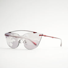 Load image into Gallery viewer, sunglasses in red stainless steel frames with colour changing photochromic one-piece lens exposed in day light 45 angled