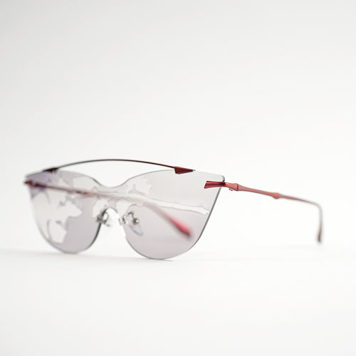 sunglasses in red stainless steel frames with colour changing photochromic one-piece lens exposed in day light 45 angled