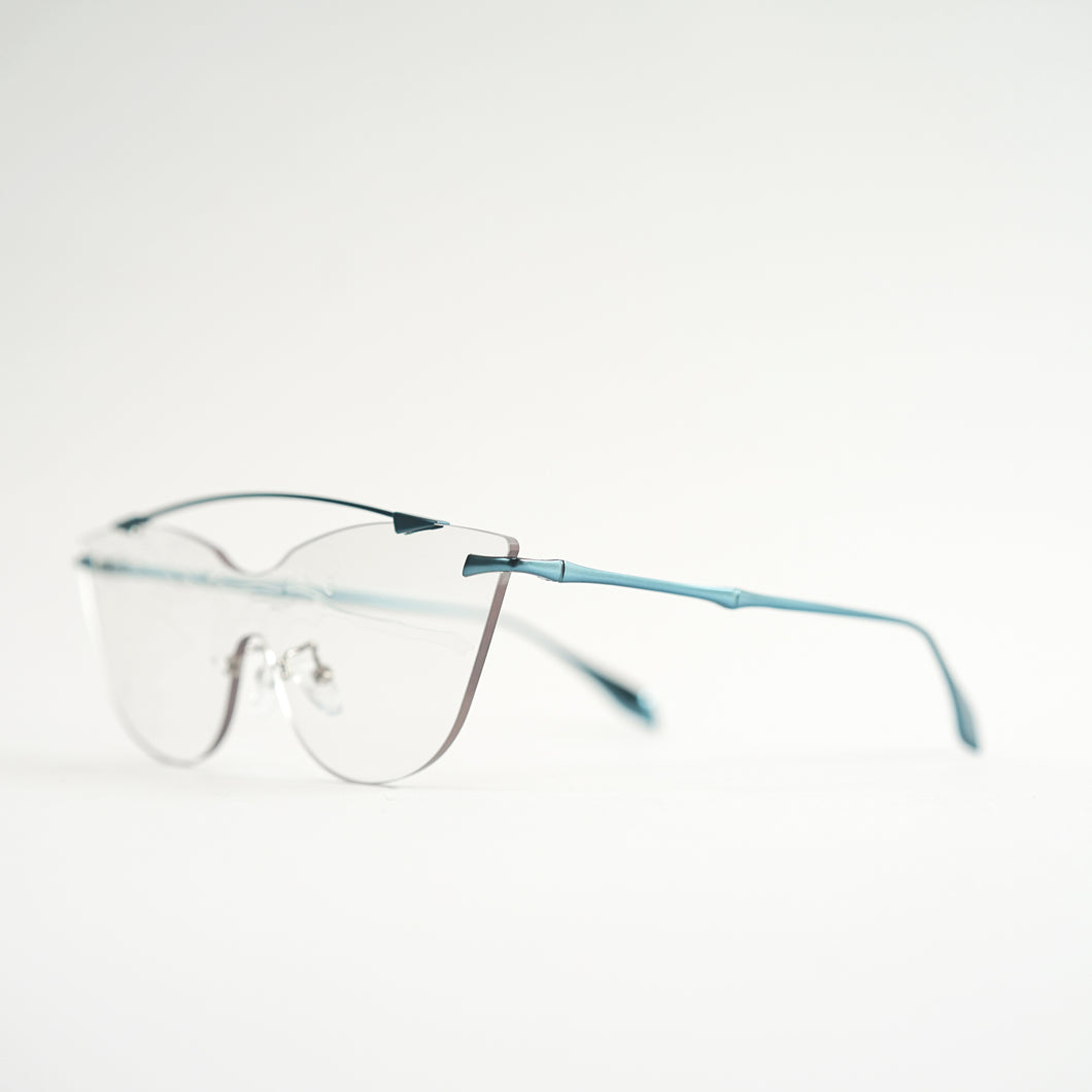 sunglasses in blue stainless steel frames with colour changing photochromic one-piece lens before exposing in day light 45 angled