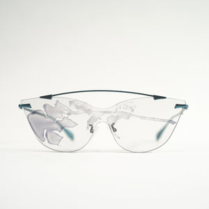 sunglasses in blue stainless steel frames with colour changing photochromic one-piece lens exposed in day light front