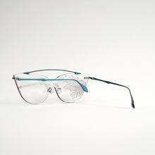 Load image into Gallery viewer, sunglasses in blue stainless steel frames with colour changing photochromic one-piece lens exposed in day light45 angled