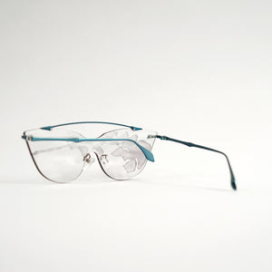 sunglasses in blue stainless steel frames with colour changing photochromic one-piece lens exposed in day light45 angled