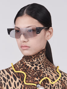 wide safety goggles style sunglasses with grey one-piece lens and marble acetate hinges on model 45 angled