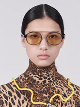 Load image into Gallery viewer, brown acetate round frames with crossed gold rims and light yellow nylon lens on model front