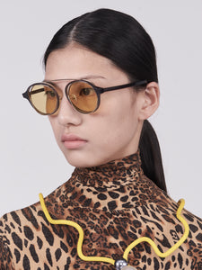 brown acetate round frames with crossed gold rims and light yellow nylon lens on model 45 angled