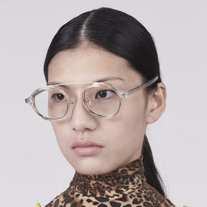 clear acetate round frames with crossed gold rims and clear nylon lens on model 45 angled