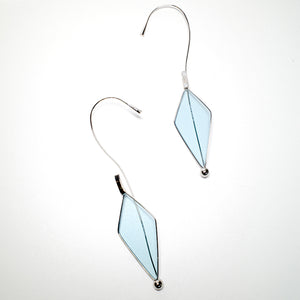 sunglasses with kite shaped light blue lens separated into two ear cuffs by the bridge