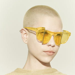 yellow jelly colour acetate frame with matching colour split polaroid lens on model 45 angled