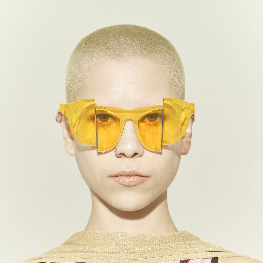 yellow jelly colour acetate frame with matching colour split polaroid lens on model front