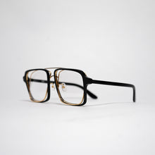 Load image into Gallery viewer, black acetate frame with crossed gold rims and clear nylon lens 45 angled 2