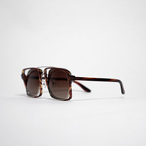 testudinarious acetate frame with crossed gold rims and gradient brown lens 45 angled 2