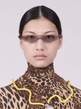 Load image into Gallery viewer, killer goggles style sunglasses with grey one-piece lens and marble hinges on model front