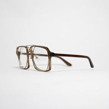 Load image into Gallery viewer, transparent brown acetate frame with crossed gold rims and clear nylon lens 45 angled 2