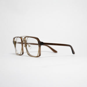 transparent brown acetate frame with crossed gold rims and clear nylon lens 45 angled 2