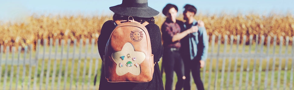 photography travel adventure eco friendly backpack vegan leather enamel pin window cute