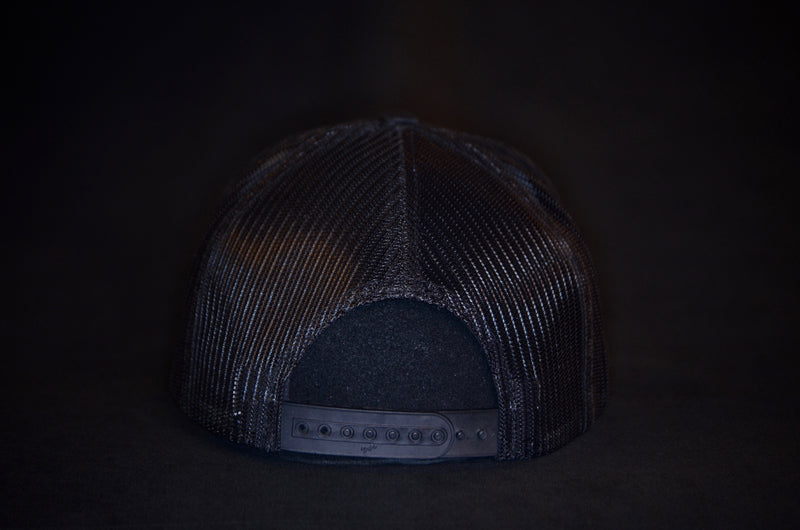 products/White_on_Black_Trucker_Hat_Back.jpg