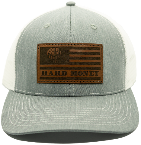 "Gray front, white mesh back. Light brown leather patch hat with dark brown accents of American flag with skull that reads ""Hard Money""."