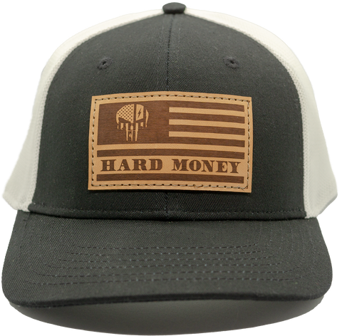"Black front, white mesh back. Light brown leather patch hat with dark brown accents of American flag with skull that reads ""Hard Money"""