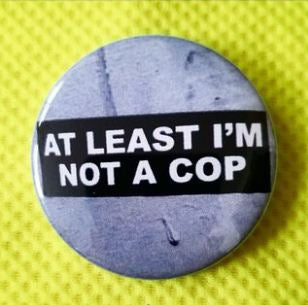 2.25 inch Not a Cop button badge pin