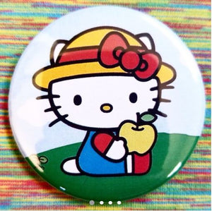 2.25 inch Hello Kitty with Apple button badge pin