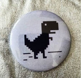 2.25 inch Loading Dinosaur button badge pin