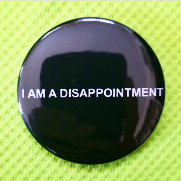 2.25 inch i am a disappointment button badge pin